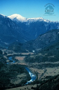 The snowcapped Andes Mountains rise over 1700 meters (5500 feet) above the river valley floor.